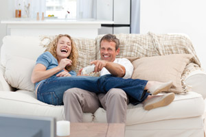 Couple on couch after ServiceMaster at Fresno upholstery cleaning
