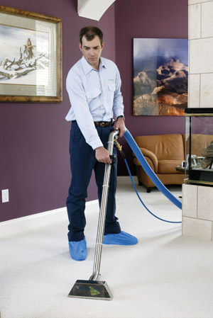 ServiceMaster at Fresno technician cleaning carpet