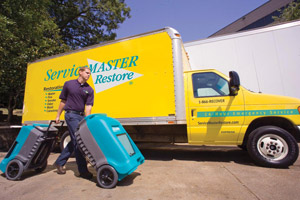 ServiceMaster at Fresno technician bringing dehumidifiers for water damage restoration