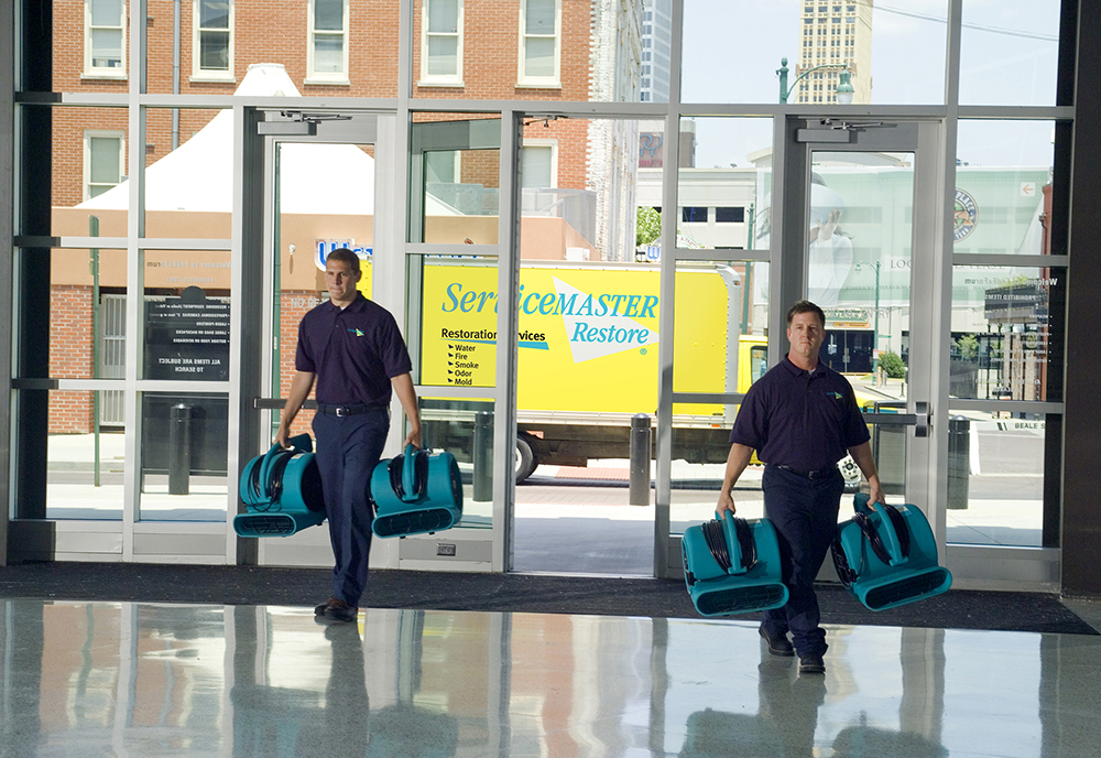 ServiceMaster techs entering a building in Fresno